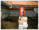 A-1 Home Inspection of Tunnel jack holding up a floor joist!